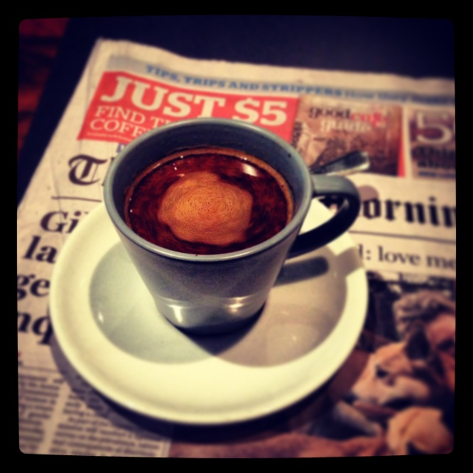 this is a photo of coffee and a newspaper