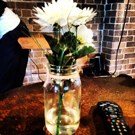 this is a flower in a jar